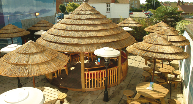 Thatched umbrellas tiki bar covers tropical parasols