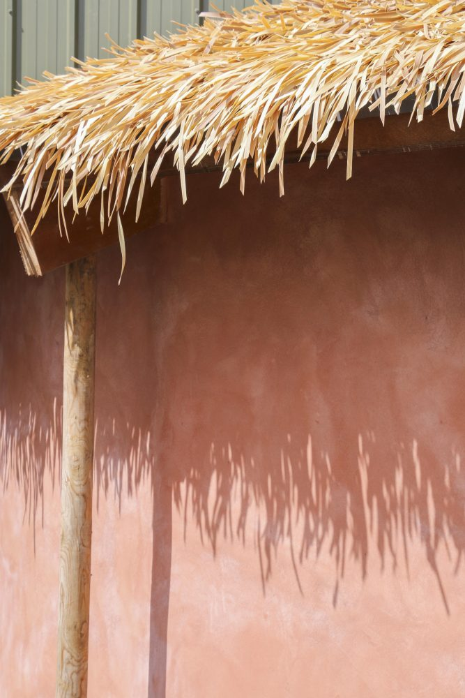 A close up of the thatched roof overhanging the exit of the Chimpanzee Eden at Twycross Zoo. Artificial Fibre Palm thatching supplied by Africa Roofing