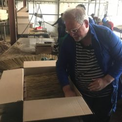Our Commercial Manager David Davies has a go at packing some of our thatch tiles into boxes ready to be shipped